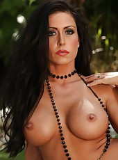 Jessica Jaymes shows off her toned tan body and fingers her tight pussy.