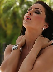 Jessica Jaymes shows off her pierced nipples, pierced pussy and big clit.