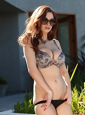 Sexy Sabrina Maree strips from her bra and panties outside.