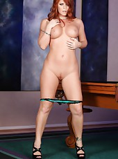 Sexy Sara Leona strips from her tight dress and masturbates on the pool table.