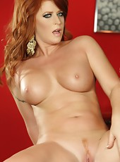 Sara Leona shows off that gorgeous red hair, big tits, round ass and smooth pussy.