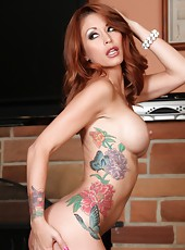 With legs that go one for miles and gorgeous red locks, Monique Alexander is sure to get your rocks off in this sexy photo set.