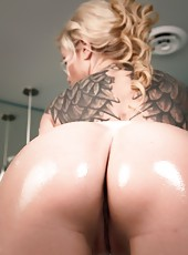 Busty, blonde, Angie Savage gets soaped up all slippery and shiny asnd shows you how a girl uses a tub to her advantage.