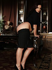 Beautiful busty brunette, Aria Giovanni, gets dressed up in her black shirt, skirt, heels with her long black hair up. She lets her hair down and strips off her secretary look.
