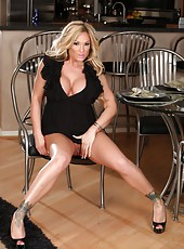 Hot busty blonde, Tyler Faith, had so much fun shooting in her black dress. Her curves look so hot and sexy with very little left to the imagination.