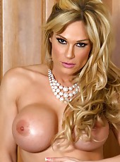Naughty busty blonde, Tyler Faith, looks oh so pretty in her sexy dress and pearls.  She puts on a sexy striptease revealing her big boobs and smoking hot body!