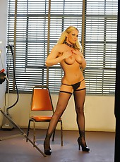 Busty blonde babe, Tyler Faith, looks oh so naughty wearing nothing but her black heels, black fishnet thigh high stockings and black heels!
