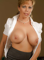 Sexy MILF Amber Lynn Bach shows off her thigh highs and pretty pussy.