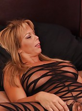 The sexy MILF Amber Lynn Bach gives her man a juicy blowjob then fucks the shit out of him.