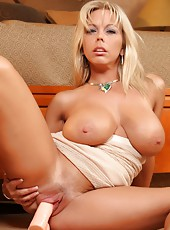 Amber Lynn Bach shows off her sexy body then masturbates with a big dildo.