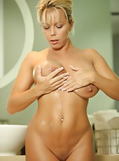 Amber Lynn Bach runs her fingers all over her naked hot body.