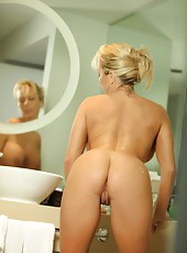 Amber Lynn Bach runs her fingers all over her naked hot body.
