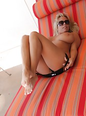 Amber Lynn Bach lounging in the Arizona sun in her sexy bikini.