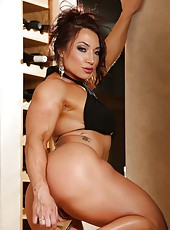 Bodybuilder Brandi Mae strips off her clothes exposing her hard muscles, big clit and nipple piercings.l