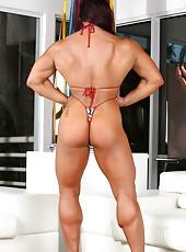 Bodybuilder Amber Deluca strips off her bikini and flexes her huge muscles.