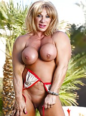 Bodybuilder Kat Connors strips off her bikini and shows us her big clit.