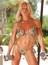 Gina struts her toned, ripped up body as she poses and flexes in her bikini.