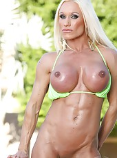 Blonde bodybuilder Ashlee Chambers shows off her muscles as she poses in her bikini, then nude.
