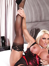 Ashlee Chambers gets dolled up in her sexy corset, garter belt, thigh high and heels. It fits nice and tight showing off her muscles.