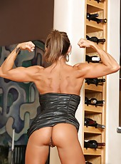 Fitness beauty, Abby Marie poses and models her sexy silver, very tight dress.