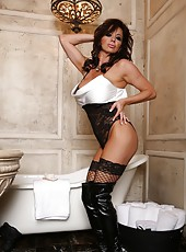 Rachel Aziani stands in her sexy thigh highs and boots as she inserts her diamond butt plug.