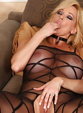 Naughty Rachel Aziani poses in her sexy crotchless bodystocking.