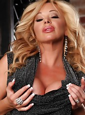 Rachel Aziani shows off her toned body including her big tits and big clit.
