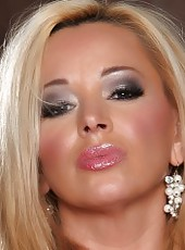 Sexy busty babe, Rachel Aziani, puts on a sexy striptease. She grew out her pussy hair and notices it really accentuates her big puffy lips and hard clit.