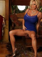 Busty blonde, Rachel Aziani, gets excited lifting up her blue lingerie exposing her shaved smooth pussy and big hard clit. She couldn