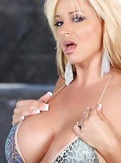 Sexy busty blonde, Rachel Aziani, is a vision posing by the pool in her tiny bikini. Even better is when she decides to strip it off revealing her big tits and amazing body.