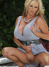 Gorgeous blonde, Rachel Aziani, poses outdoors in the California sun.  She can