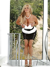 Sexy busty blonde, Rachel Aziani, looks stunning in her hot high heels, short leather skirt and low cut top.  She looks even better out of them!