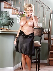 Busty blonde babe, Rachel Aziani, puts on a sexy striptease out of her hot black dress and shows off her incredible tits and body!