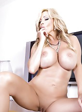 Beautiful busty blonde, Rachel Aziani, puts on a slow sexy striptease out of her dress revealing her amazing big tits and smooth shaved pussy!