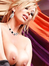 Busty blonde babe, Rachel Aziani, looks stunning in her long black dress and gloves!  She loves flashing her beautiful boobs and sweet shaved pussy!