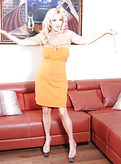 Rachel in a tight orange dress showing off her hairy little pussy