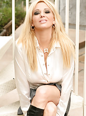 Rachel Aziani shows off a lot more than just her hot leather boots and mini skirt.