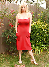 I was out shooting in LA along with a few of the other Aziani models. Tyler Faith was sweet enough to let me borrow her sexy red dress. I have to say it fit like a glove...it even held up by big natural boobies without a bra which isn