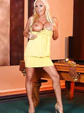Blonde bombshell Mary Carey shows off her big titties and tight little pussy.