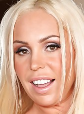 Blonde beauty Mary Carey is showing off her tan curvy body while masturbating. Mmmm