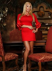 Gorgeous busty blonde, Mary Carey, is stunning in her red silk dress and heels.  Even better is when she strips down revealing her big tits and amazing body!