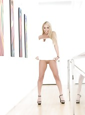 Beautiful busty blonde, Mary Carey, gives an up skirt peek at her plump pussy and shows off her hot and sexy body in a white dress.
