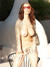 Busty brunette, Nikki Nova is outside in the hot sun in a beaded belt and a sparkly cropped shoulder wrap in her shades and heels!