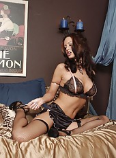 Nikki Nova is stunning in her sexy black lingerie and fishnet thigh-high stockings!