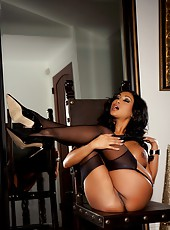 Beautiful busty Indian, Priya Anjali Rai, is a vision stripping out of her sexy green corset and panties, but leaves her garter and black thigh high stockings on while spreading her legs!