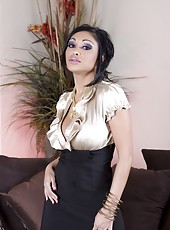 Busty Indian Pornstar, Priya Anjali Rai, looks stunning in her skin-tight outfit and playing with her sexy shaved pussy!