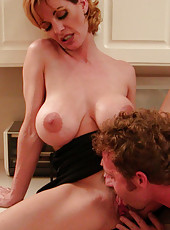 Limber reheaded milf sits on fat cock and cums hard