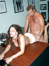 Brunette milf gets boned by the hunter in her office on break