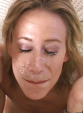 Cute milf babe takes a facial and loves it