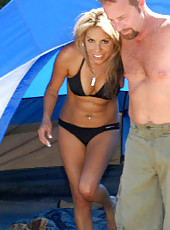 This hot camping out milf is getting her ass lubed up in these hot tent sex pics